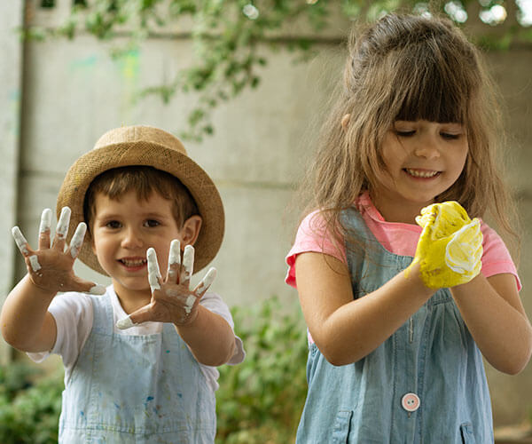two kids playing with paint